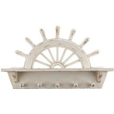 Steer your wall decor in the right direction withAntique White Wood Ship Wheel Shelf with Hooks. With a half ship's wheel in the back, this white piece includes a shelf for displaying small items and trinkets and five hooks for you to hang purses, bags, sweaters, and more.