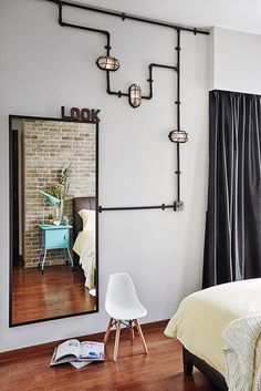 The owners wanted industrial-style lighting to give the bedroom an urban edge.