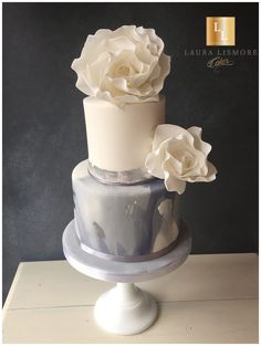 Two tier marble wedding cake with edible silver leaf