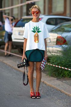 Cool and laid back with green shorts, and red sunnies