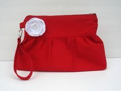 Red clutch with white flower. $17.50, via Etsy.