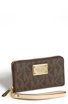 Michael Kors phone case/wallet. I have this, it's so pretty and handy when you don't want to carry a handbag :)