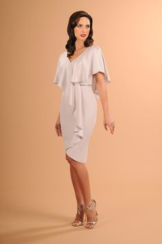 6418c93ba8f You will look elegant in this Daymor 609 cocktail dress. The skirt features  a modest petal hemline.