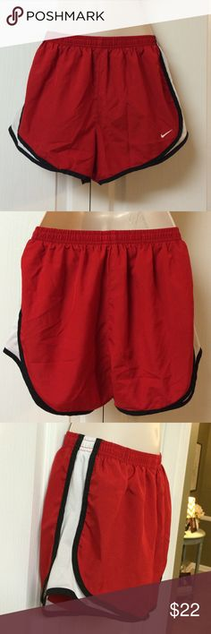 Nike lined Dri-Fit shorts Classic lined dri-fits. Red with white mesh sides. Pre loved. Elastic waistband but Drawstring is missing. Outside is in awesome shape. Lining shows some light wear. Liner pocket. 100% polyester. Nike Shorts