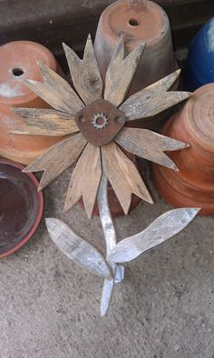 flowers from repurposed picket fences and old rusty hardware