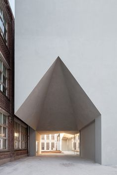 all-white building by aires mateus unites architecture school in belgium