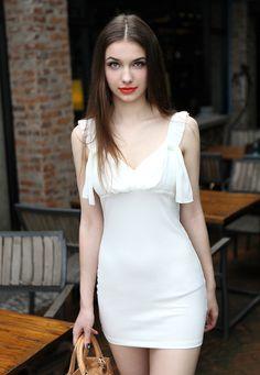 Morpheus Boutique  - White Ruffle  V Neck Backless Banded clubwear Mini Dress