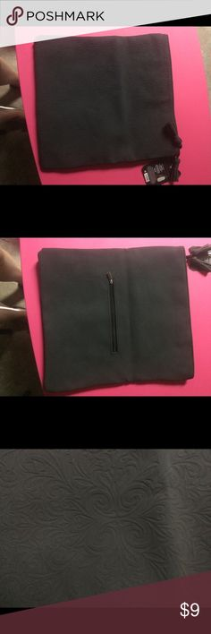 Ion color brilliance black bag One inside zipper and on outside zipper on the back side.  Tassels on zipper closure.  12.5X11W. NWT.  Tag says it comes with two clips and an application bottle but neither were included. Bags Cosmetic Bags & Cases