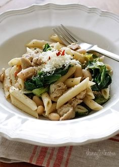 Penne pasta is tossed with garlicky escarole, lean Italian chicken sausage, cannellini beans, crushed red pepper and grated cheese. I cannot even begin to describe how good this is! Smart Points: 10 Calories: 332