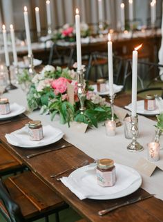 Table setting with silver candle sticks.