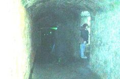 "EDINBURGH VAULTS! It's behind you: Chilling image captures ghost lurking behind tourist. The 'spectral figure' who photobombed Emma's picture is alarmingly standing directly behind her sister wearing what appears to be a long coat and boots.  She believes it may be a ghost known as 'The Watcher' or 'Mr Boots.'  She said: ""There are a lot of stories about a man down there who wears big boots and a coat and another called 'The Watcher' with long hair and 18th century clothing."