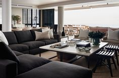 High contrast. Dark charcoal modular sofa. Light woods. Yvonne O'Brien Interior Design Bantry bay