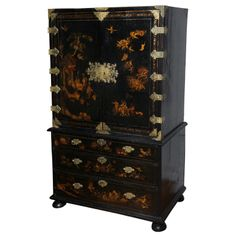 A George I Parcel-Gilt Decorated Black Japanned Cabinet on Chest