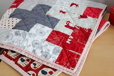 Love this quilt and the fabrics. red, grey white.