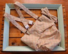 diaper cover, suspenders, & a bow tie.