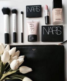 A collection of Nars makeup products, with Mac lipstick, Chanel Foundation, few brushes and a Celine makeup bag I would love to own!