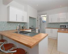 photo of beige white kitchen kitchen area