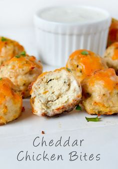 These Cheddar Chicken Bites are the perfect addition for your upcoming party. Ground chicken, Italian breadcrumbs, and cheddar cheese are rolled into bite-sized balls and baked to golden perfection. Serve this crowd-pleasing appetizer with ranch dressing.