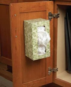 put grocery store bags in a empty tissue box and store on the inside of a cabinet door. Good idea for bathrooms - replace bag in the trash can. I have been trying to figure out how to store our bags! So glad I found a way!