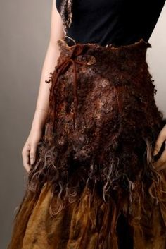 sch-ka.livejournal.com  feral and wild. reminds me of maori cloaks.
