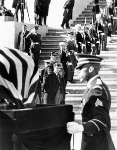 Jacqueline Kennedy, in a widow's veil, watches as coffin containing the body President John Kennedy, is placed on caisson. The coffin is leaving the Capitol in procession to St. Matthews Cathedral, for a high requiem funeral mass. Nov. 25, 1963.
