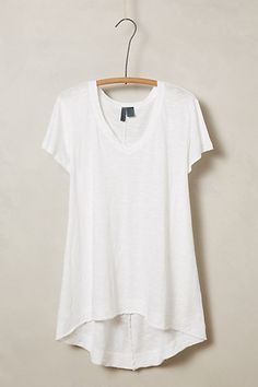 Catarina Tee - anthropologie.com  Every girl should have one of these in their closet. Throw on with a great pair of jeans and sneakers or flats. You can tuck the front in and wear a fab belt to dress this up a little.