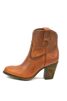 "A short western boot with a refined point-of-view. Beautiful stitching and a high, stacked leather heel take the classic cowboy boot a new level. The leather is washed, oiled and distressed for a perfectly worn look. Barn dances to nightclubs, these boots know how to rope them in. Pull-on.    Measures 4"" shaft height - 12"" shaft circumference - 3 1/5"" heel height   Refined Western Bootie by Frye. Shoes - Booties - Heeled California"