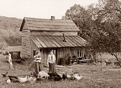 Photo of Two Ladies Feeding Their Chickens Behind the Farmhouse, Early 1900s