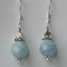 "Faceted 10mm round aquamarines and faceted sterling silver beads on sterling silver french hook ear wires. 1 1/2"" long. We can make these earrings in multiples for wedding parties. Just email us and a"
