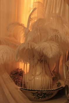Sheelin Antique Lace Shop Feathers & Lace Like the idea of decorating with feathers.