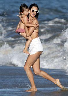 Alessandra Ambrosio frolics on the beach in Malibu, CA.