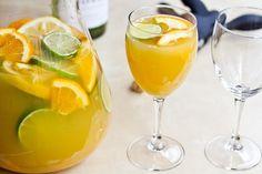 Sunny White Sangria - lemons, limes, oranges, & mango  #drinks