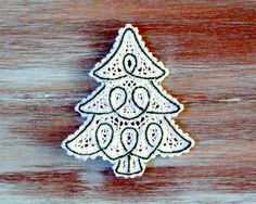 This is a beautifully embroidered lace Christmas tree ornament. Perfect for Christmas decor, or to hang on your Christmas tree! It is both a soft