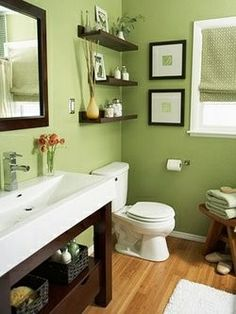 I LOVE the green, clean white, and dark wood accents with light wood flooring in this bathroom. :-)
