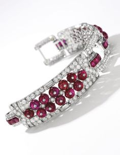 Fine ruby and diamond bracelet, Cartier, circa 1925 Of geometric design, set with calibré-cut and ruby beads, circular-cut and baguette diamonds, length approximately 165mm, signed Cartier, numbered.