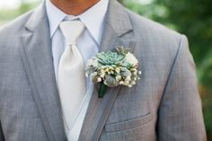 So obsessed with our succulent boutonnieres! #grivettewedding #chelseandtroy