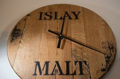 Whisky Cask End Wall Clock Made from a solid oak genuine Islay Single Malt Whisky cask. Quartz movement Approx in diameter Dimensions: (approx) Diameter: Material: Oak How To Make Wall Clock, Single Malt Whisky, T Lights, Solid Oak, Clocks, Candle Holders, Quartz, Wall Decor, Home Decor