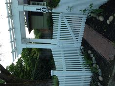 arbor and picket fence, gate is inset, as it is close to street. Walnut Creek, CA.