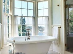 Love this bathtub overlooking the lake.  Big sunny windows.