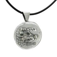 We created for you a special pendant with black satin cord, inspired by the silver Attic tetradrachm (four-drachma coin) of Thasos, depicting on the one side the bust of Dionysus and on the other Hercules and the inscription, IRAKLEOUS, SAVIOR and THASSION.  2nd century B.C., Thasos. Diameter: 2,5cm Silver 999°.