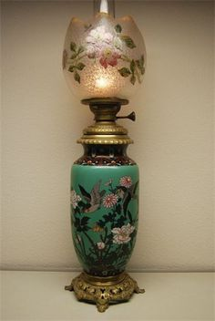 French cloisonne kerosene lamp with Baccarat shade. It should be mentioned that: most of the oil lamps values depends on the shade that they use on them. Actually, the shade is decisive about the value of the lamp mostly because it breaks very easily in the process of time. This applies specially with Gone With The Wind Oil Lamps.