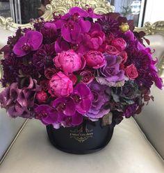 A beautiful purple floral arrangement in a hat box. Beautiful Bouquet Of Flowers, Beautiful Flower Arrangements, Amazing Flowers, My Flower, Floral Arrangements, Beautiful Flowers, Wedding Flowers, Succulent Centerpieces, Floral Centerpieces