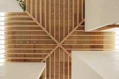 """Japanese architecture studio mA-style architects designed the 'Light Walls House', a minimal home with wooden roof beams that diffuse natural sunlight in a unique way. Located in a residential area in Toyokawa, the sun-drenched interiors consist of four individual boxes that act as private spaces and can be entered via ladders.  On the inspiration behind the building's concept, the architects say: """"Considering each box as a house, the empty spaces in between can be seen as paths or plazas…"""