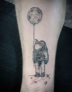 Astronaut With Crater On A String Tattoo On Guys Arms