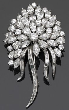 A diamond brooch-pendant designed as a bouquet of round brilliant marquise pear and baguette-cut diamonds; estimated total diamond weight: 18.00 carats; mounted in platinum.
