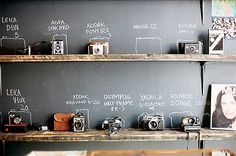 "cool for some ""art"" {vintage camera display, reclaimed shelving and chalkboard wall} could also incorporate some vintage Mic's and radios for ""sound"" element Old Cameras, Vintage Cameras, Antique Cameras, Vintage Camera Decor, Polaroid Cameras, Vintage Display, Vintage Typewriters, Digital Cameras, Labo Photo"