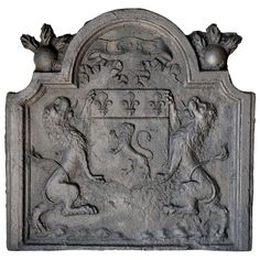 French Louis XIV Period Cast Iron Fireback, Dated 1683 | From a unique collection of antique and modern fireplace tools and chimney pots at http://www.1stdibs.com/furniture/building-garden/fireplace-tools-chimney-pots/