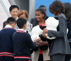 Michelle Obama Photos Photos - (CHINA OUT) First Lady Michelle Obama arrives at Chengdu Shuangliu International Airport on March 24, 2014 in Chengdu, Sichuan Province of China. Michelle Obama's one-week-long visit in China will be focused on educational and cultural exchanges. Michelle Obama's one-week-long visit in China will be focused on educational and cultural exchanges. - Michelle Obama Travels to China: Day 5