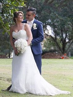 Bride is wearing an ivory silk French lace wedding gown by personalisedweddingscouture.com.au at Earlwood #weddings #weddingdress #brides #bridalgown