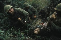 Photographer Robert Ellison, 23, captured this image of the Marines dragging the body of 2nd Lt. Donald Jacques, 20, out of the underbrush near Khe Sanh on Feb. 25, 1968. (Robert Ellison/Black Star)